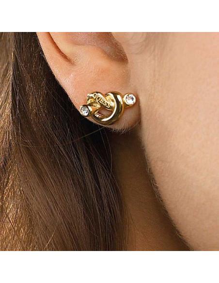 Pendientes Guess Knot nudo dorado UBE29013 en acero chapado en oro y cristales Swarovski® puestos